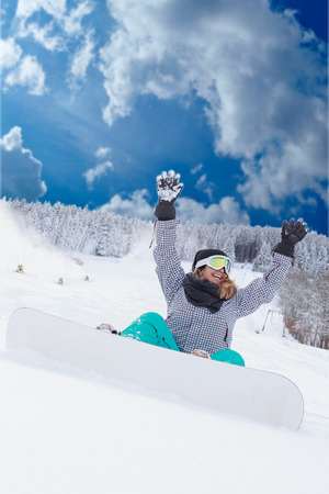 chubby girl: Young blonde chubby girl Oversized sitting with your snowboard in the snow and looking forward with hands raised