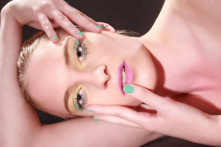 erotically: Nice close girls portrait with colored makeup and green fingernails