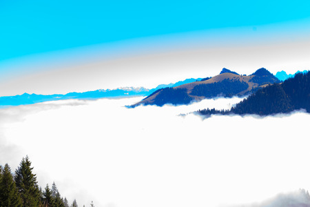 kaiser: Panoramic view from the Bavarian mountains of the Kaiser mountains in Tyrol in Austria, above a wall of fog