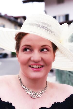 curvy woman: Face portrait of a curvy woman in a black evening dress and White Sun Hat Stock Photo