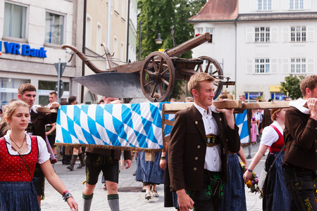 farm implement: Rosenheim, Germany - September 4, 2016: Old plow young farmers at Thanksgiving Parade in Rosenheim  Germany