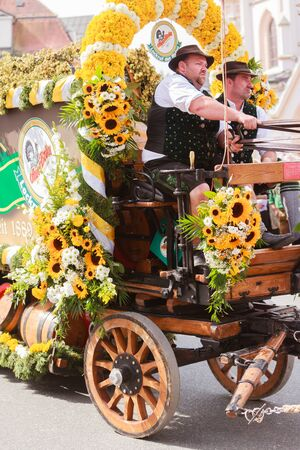 Rosenheim, Germany - September 4, 2016: coachman of horse carts of AuerBräu brewery at Thanksgiving Parade in Rosenheim  Germany