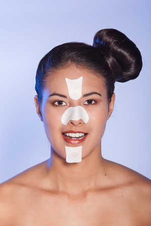 scarring: Young woman with facestrips and nosestrips in her face