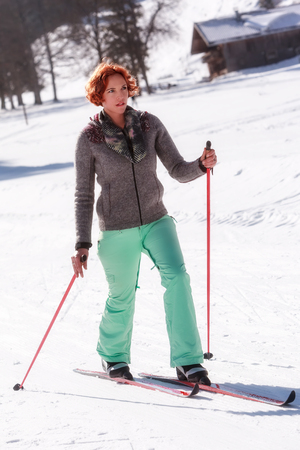 Young woman finds rest at the cross-country skiing in the beautiful Bavarian winter landscape