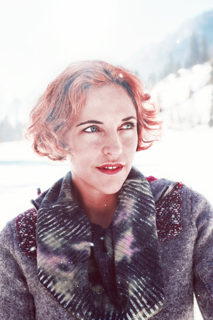 Closeup of a young woman out on a cold winters day