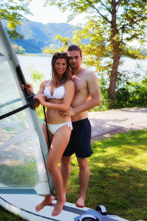 Attractive student with your surf instructor during training