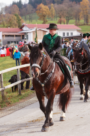 Hundham, Bavaria - November 4, 2017: Every year on the 1st Saturday in November the Idyllic Horse procession, named Leonhardi in the Bavarian Hundham takes place in memory of Patron St. Leonhard. In traditional clothing and decorated horse-drawn carriages
