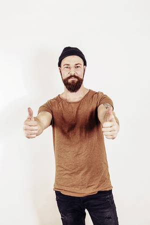 Portrait of a man with both thumbs up, studio shot