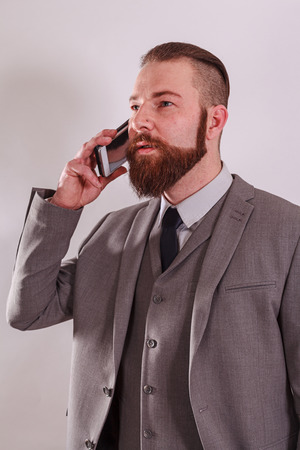 Successful businessman with mobile phone