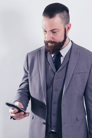 Successful businessman with mobile phone on the phone