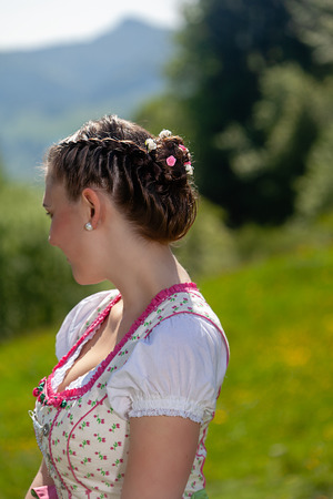 Portrait of a Bavarian girl in a dirndl with braided hair and beauty in her hair Stock Photo