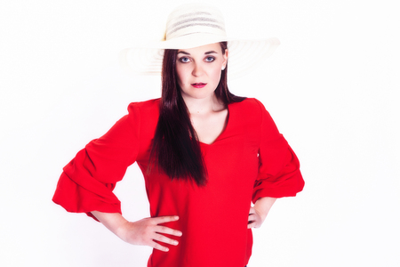 Long-haired young woman with a sun hat. Studioshoot - Landscape