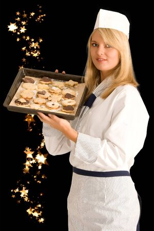 Baker with a baking tray full of delicious Christmas cookies