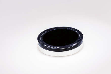 Flat metal box with black lid and silver bottom isolated on white.