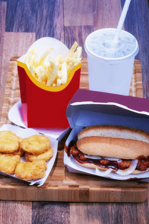 Classic fast food, with nugets, burgers, fries and shakes with packaging Standard-Bild