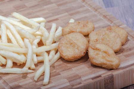 Chicken nugets with French fries Standard-Bild