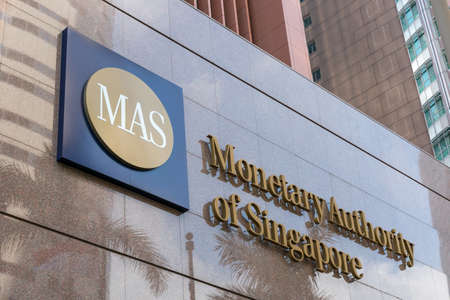 Monetary Authority of Singapore (MAS) logo signage on the building at entrance.