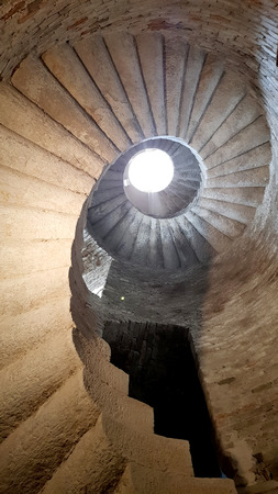 An amazing ancient spiral staircase in an italian castle tower Standard-Bild - 105981396