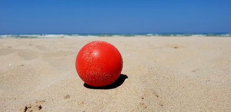 Ball on the beach in a sunny day in total relaxation on the Italian adriatic beach