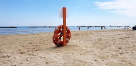 Beach lifeguard in adriatic beach Standard-Bild - 105981595