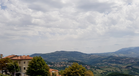 Cloudy and sunny sky with amazing italian summer landscape Standard-Bild