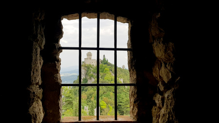 Ancient terrifying jails in italian castle with views through the bars Standard-Bild - 105981699