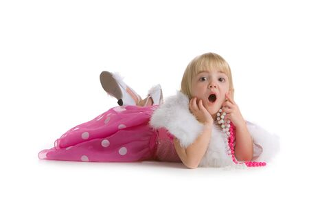Little girl in pink dress with surprised expression