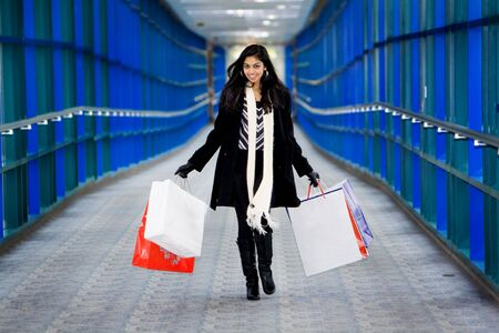 Women with bags in hallway