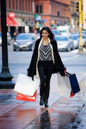 Woman with bags on city street