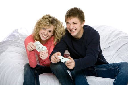 Attractive teenagers playing video games Stock Photo