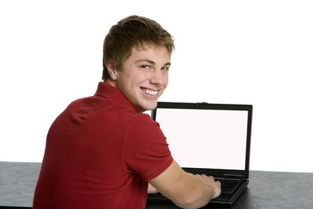 lap top: Attractive teenage boy using a lap top Stock Photo