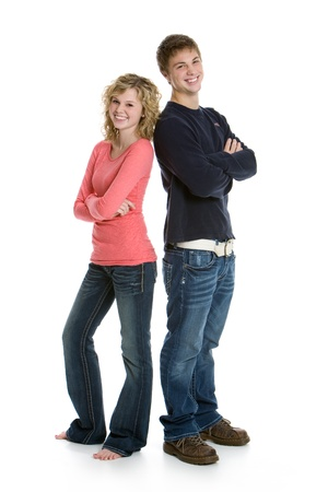 Attractive teenage couple standing back to back with arms crossed isolated on white background