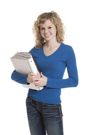 Cute teenage girl holding books on white background