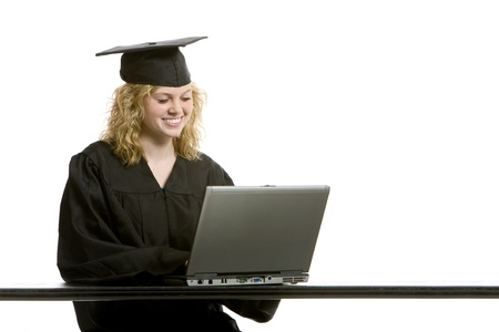 online degree: Young graduation girl on computer with white background Stock Photo