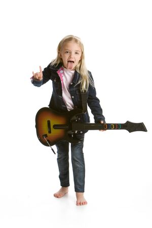 Cute little girl playing video game guitar and rocking out
