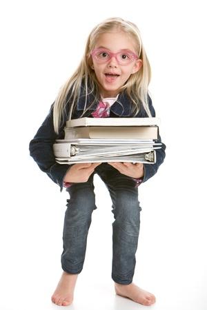 Cute little girl holding books 写真素材