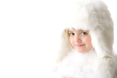 cute little girl wearing a white fur coat and hat isolated on white background