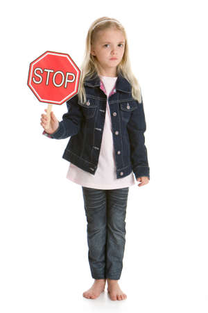 Cute little girl isolated on a white background holding a stop sign, looking