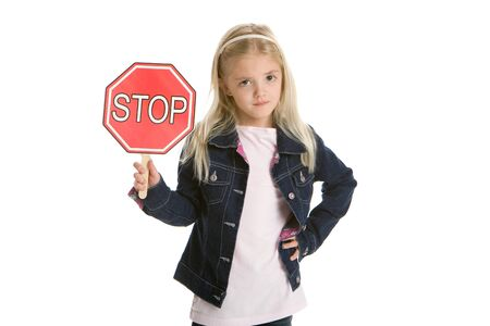 Cute little girl isolated, holding a stop sign 写真素材