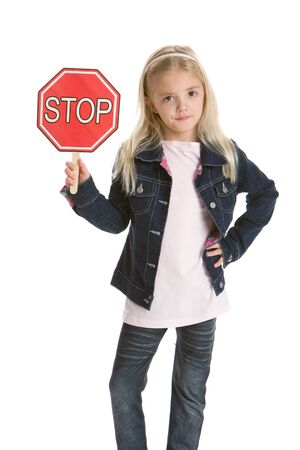 Cute little girl isolated on a white background holding a stop sign