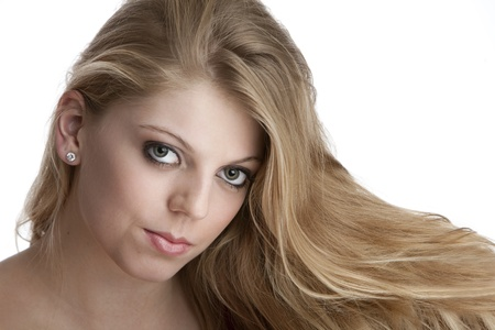 Intense close-up of pretty teenage girl with big eyes and beautiful blond hair