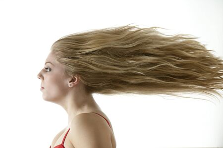 Stunning teenage girl with extreme blowing hair photo