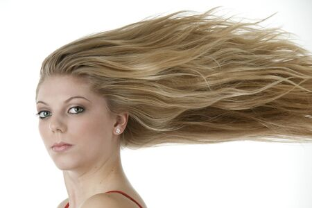 Stunning teenage girl with extreme blowing blond hair photo