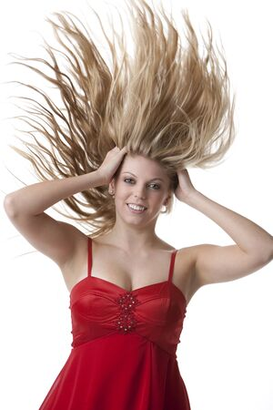 dress blowing in the wind: Beautiful blond teenage girl with flying hair Stock Photo