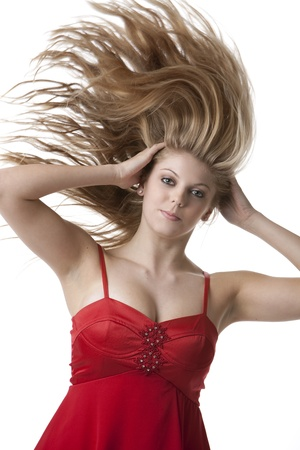 Beautiful blond teenage girl with flying hair isolated on white background