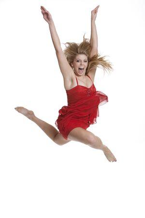 Beautiful teenage girl jumping isolated on white background