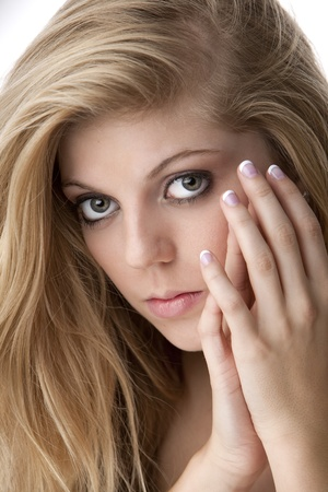 french manicure sexy woman: Intense close-up of pretty teenage girl with big eyes and beautiful hair and nails