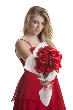 Beautiful teenage girl in a red dress holding a bouquet of roses isolated on white background 写真素材