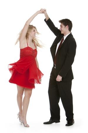 couple dancing: Atractiva pareja adolescente bailando sobre fondo blanco aislado Foto de archivo