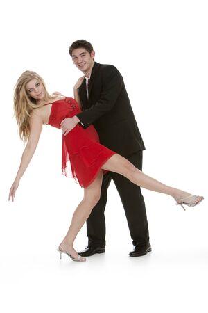 Teenage couple dancing on isolated white background